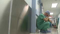 Job stress gets to a young surgeon - stock footage
