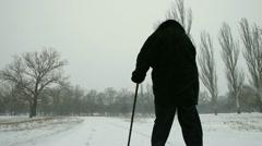 Senior Woman Walking Away Stock Footage