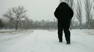 Senior Woman Walking Out in Blizzard Stock Footage