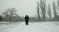 Old Woman Walking In Winter Stock Footage