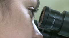 Closeup of eyes looking through microscope (2 of 3) Stock Footage