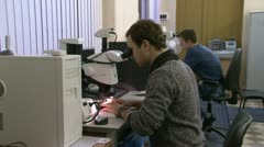 A scientist at the microscope Stock Footage