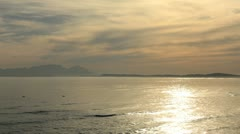 Table Mountain Sunset from The Strand across False Bay Stock Footage