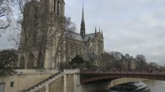 Beautiful Notre Dame Cathedral in Paris church bridge river sena Stock Footage