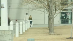 People walking into a building (2) Stock Footage