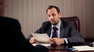 Businessman and man having job interview in a office HD Stock Footage