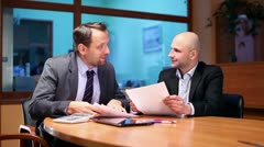 Two businessmen working with documents in the office, steadicam shot HD Stock Footage