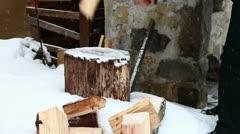 Man splitting wood wintertime Stock Footage