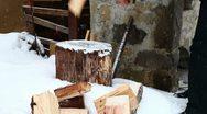 Stock Video Footage of Man splitting wood wintertime