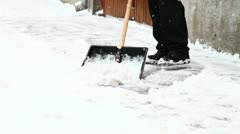Man shoveling snow - stock footage