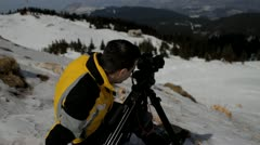 Man with camera on mountain 02b Stock Footage