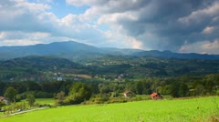 Landscape Mountains hills meadow and blue cloudy sky Stock Footage