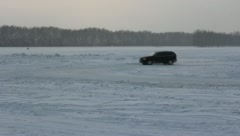 Vehicles traveling along the slippery winter roads. HD H.264 Stock Footage