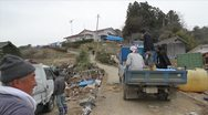 Japan Tsunami Aftermath-Survivors Get Supplies Stock Footage