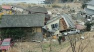 Japan Tsunami Aftermath-Crushed Car and House Stock Footage