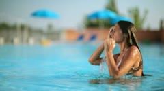 Beautiful woman relaxing in pool; Full HD Photo JPEG Stock Footage