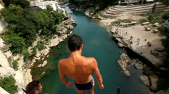 Traditional jump from Old bridge in Mostar - stock footage