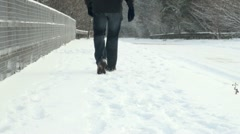 Walking on Snow Covered Road Bridge - stock footage