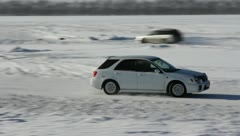 Vehicles traveling along the slippery winter roads. Stock Footage