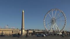 Place de la Concorde and Ferris-wheel paris traffic street car Stock Footage