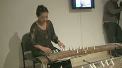 A woman playing a Koto zither jūshichi Stock Footage