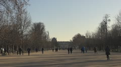People walking in Tuileries Gardens, Paris, France holiday sunny day park Stock Footage