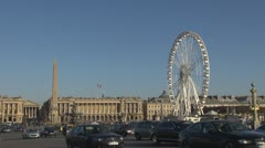 Place de la Concorde and Ferris-wheel paris street day car traffic Stock Footage