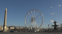 Place de la Concorde and Ferris-wheel paris obelisk monument fountain public Stock Footage
