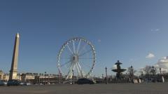 Place de la Concorde and Ferris-wheel paris france street car traffic Stock Footage