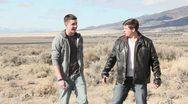 Teenagers throwing rocks in the desert Stock Footage