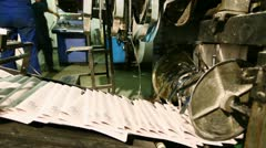 ready newspaper on production line in a print shop - stock footage