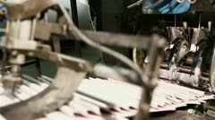 close-up newspaper on production line in a print shop - stock footage