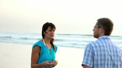 Relationship difficulties, young couple fighting by the beach, steadicam shot - stock footage