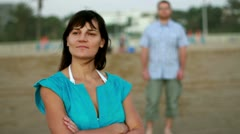 Young man surprising and kissing woman at the beach, steadicam shot Stock Footage