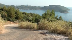Curved road downhill with magnificent view on bay - stock footage