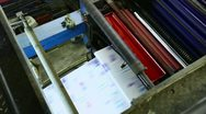 Stock Video Footage of set up print shop machine detail cmyk colors
