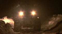 Loader on Snowy Road Moves Away During Snowstorm 1 Stock Footage