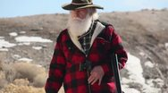 Stock Video Footage of Old man with beard hunting walking