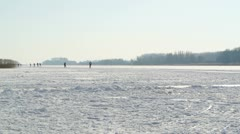 Ice skating on a lake Stock Footage