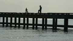 Fishing off pier Stock Footage