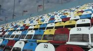 Man on colored seating Daytona, Daytona Speedway Stadium Stock Footage