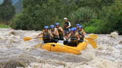 PATATE, ECUADOR - 21 APRIL 2012: whitewater rafting on the rapids of the river Stock Footage