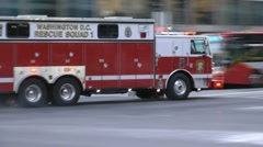 Stock Video Footage of Rescue Squad 1, DC Fire Department races past commuters.