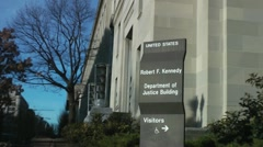 Sign at US Department of Justice Building, zoom tighter Stock Footage