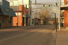 Downtown Small Village with Traffic Light, traffic, and bicyclist Stock Footage