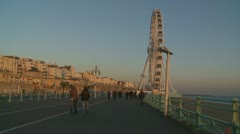 Walking towards the Brighton big wheel glidecam Stock Footage