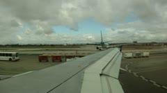 POV airplane wing on tarmac transportation passenger travel vacation - stock footage
