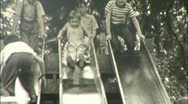 Stock Video Footage of KIDS PLAY Fun on Slide PLAYGROUND Sliding 1940s Vintage Film Home Movie 114