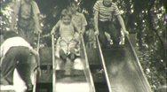 Stock Video Footage of KIDS PLAY Fun on Slide PLAYGROUND Sliding 1940s Vintage Film Home Movie 114