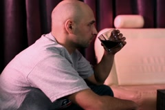 Sad lonely man drinking in bar, steadicam shot NTSC Stock Footage